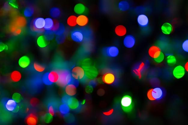 Kolorowe boże narodzenie światła bokeh w tle
