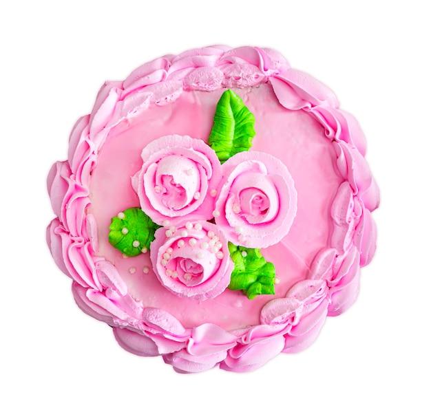 Kolorowe ciasto ozdobione kremowymi kwiatami i izolowany na białym tle. na białym tle ciasto. różowy krem ciasto widok z góry.