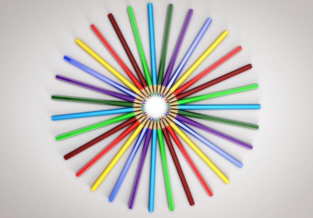 Kolorowe kredki rozłożone w kółko. wszystkie kolory tęczy.