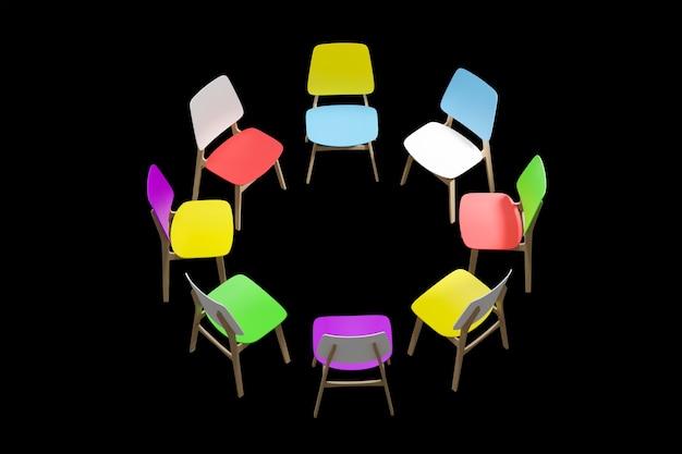 Kolorowe krzesła stoją w kręgu na czarnym tle.