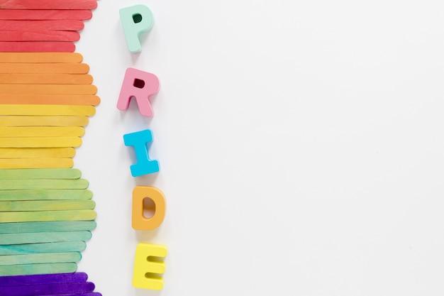 Kolorowe patyczki z wyrazem dumy