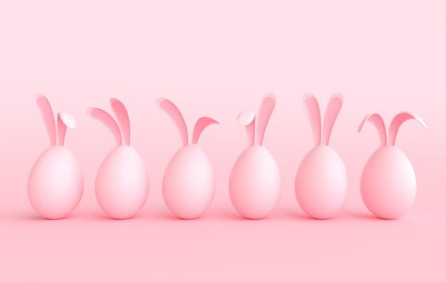 Kolorowe pisanki z uszami królika na pastelowym różowym tle