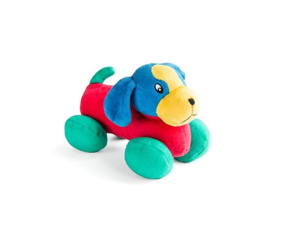 Kolorowe pluszowe zabawki pluszowe pies na białym tle zielony czerwony niebieski pies