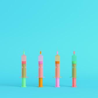 Kolorowe strzykawki ze szczepionkami na jasnym niebieskim tle w pastelowych kolorach. koncepcja minimalizmu. renderowania 3d