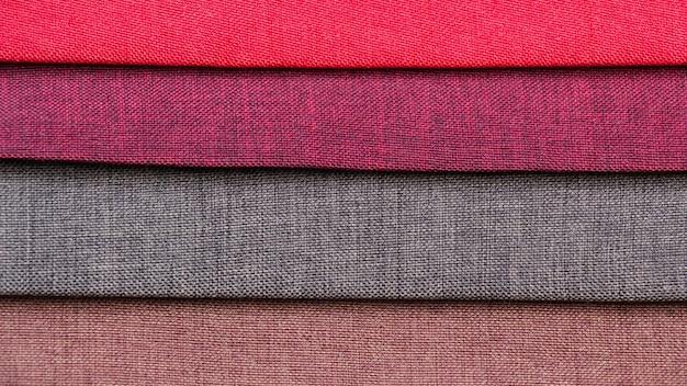 Kolorowe tło, stos kolorowych tkanin.
