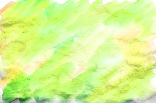 Kolorowe zielone i żółte tło akwarela. aquarelle jasny kolor