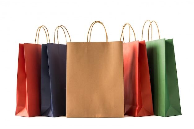 Kolorowi papierowi torba na zakupy na białym tle
