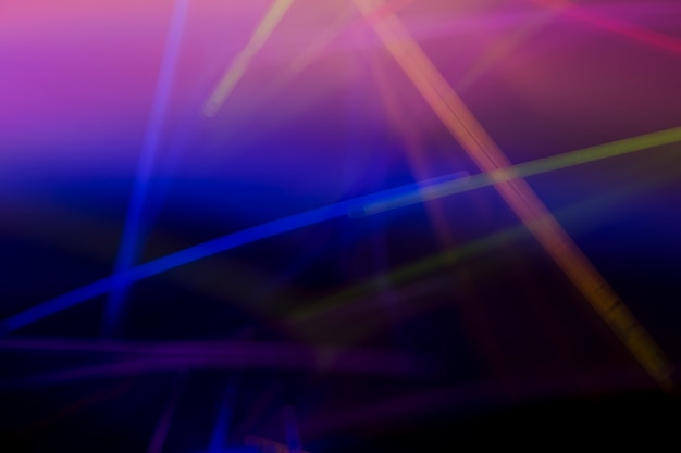 Kolorowy neonowy laser zaświeca abstrakcjonistycznego tło