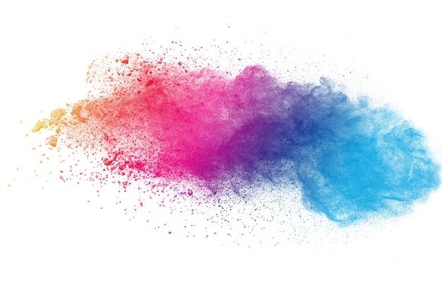 Kolorowy prochowy wybuch na białym tle. plusk cząstek streszczenie pastelowy kolor plusk.