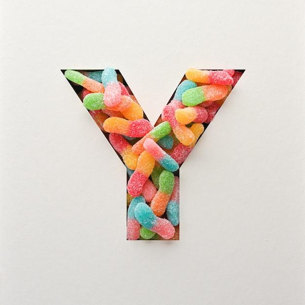 Kolorowy projekt czcionki, abstrakcyjna czcionka alfabetu z galaretką, realistyczna typografia - y