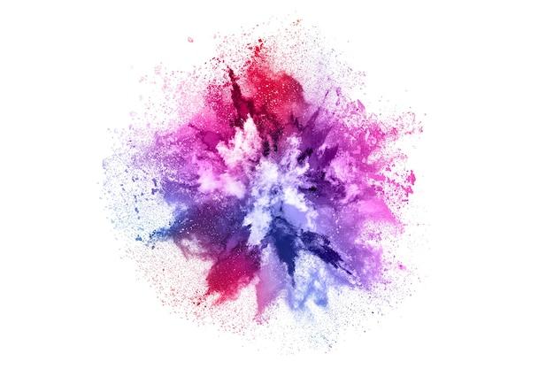 Kolorowy wybuch proszku na białym tle