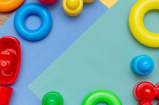 Kolorowych dziecko dzieciaka edukaci zabawek ramowy tło