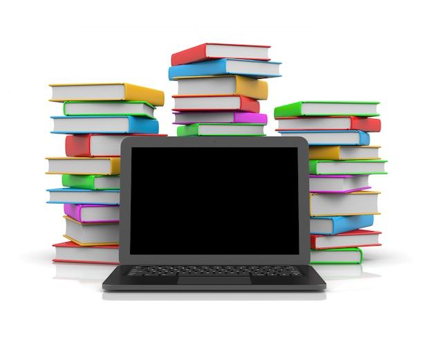 Komputer przenośny przed stosem książek
