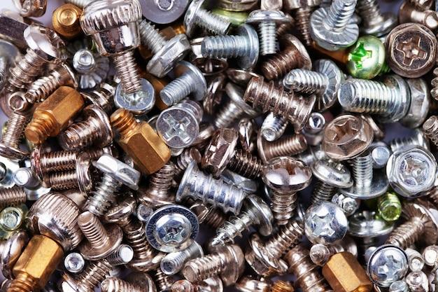 Komputerowe srebrne i złote śruby tekstury tła, sprzętu, śrub i nakrętek