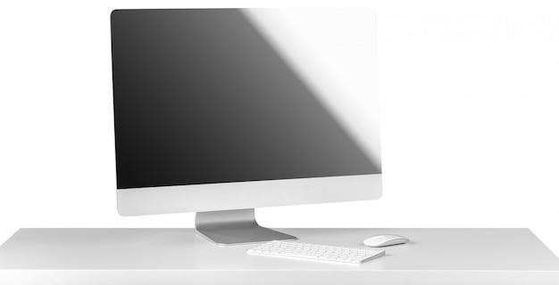 Komputerowy monitor czarny ekran z klawiaturą na białym stole.
