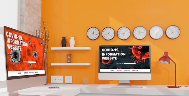 Komputery stacjonarne na stole w biurze z zegarami ściennymi