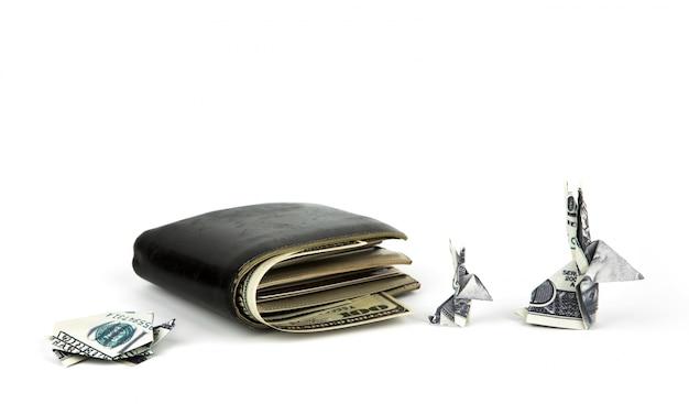 Koncepcja biznesowa: dolar waluty origami królik i żółw w