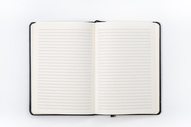 Koncepcja biznesowa - widok z góry kolekcja czarnego notebooka na białym tle biurka do makiety