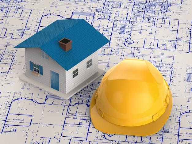 Koncepcja budowy domu z makietą modelu domu z kaskiem ochronnym