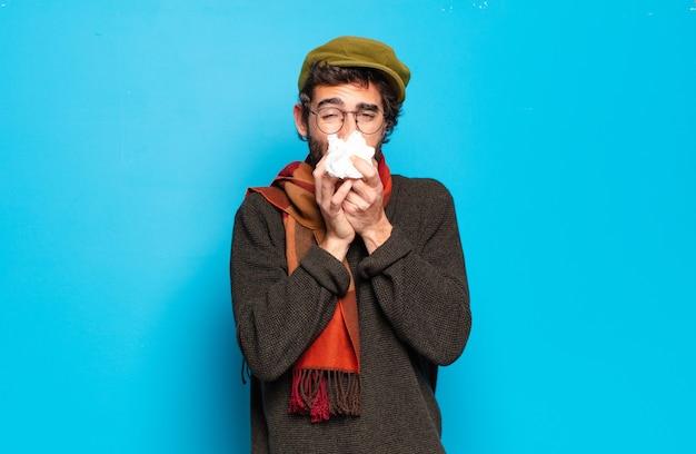 Koncepcja choroby młody brodaty mężczyzna. ból przeziębienia i grypy