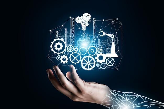 Koncepcja futurystycznego przemysłu 4.0 - inżynieria z graficznym interfejsem pokazującym projekt automatyzacji, działanie robota, wykorzystanie maszynowego uczenia głębokiego dla przyszłej produkcji.