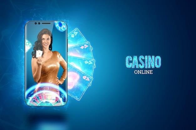 Koncepcja kasyna online, hazardu, gier pieniężnych online, zakładów. smartphone i ładna dziewczyna z kartami do gry w ręku. nagłówek strony internetowej, ulotka, plakat, szablon reklamy.