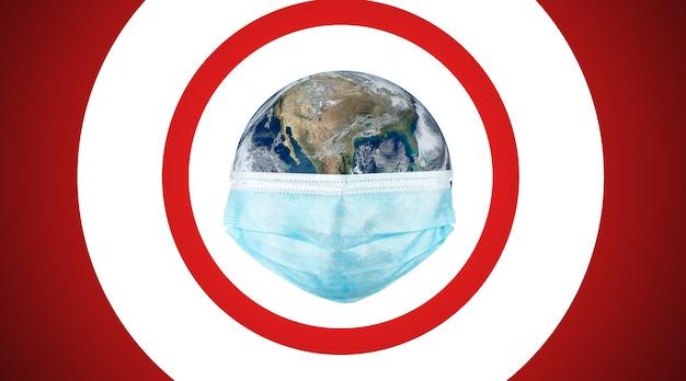 Koncepcja koronawirusa grypy covid-19 . ziemia z maską na twarz chroni świat medyczny. (obraz elementu świata autorstwa nasa)