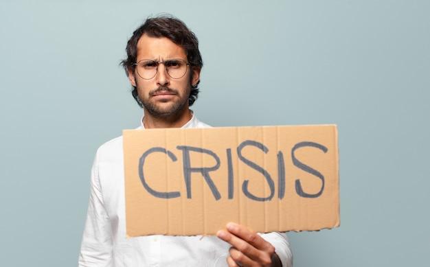 Koncepcja Kryzysu Młody Przystojny Indyjski Człowiek Premium Zdjęcia