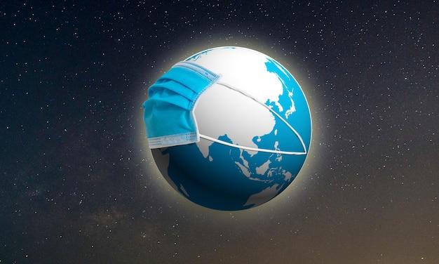 Koncepcja kuli ziemskiej z maską, save the earth, podczas epidemii covid-19