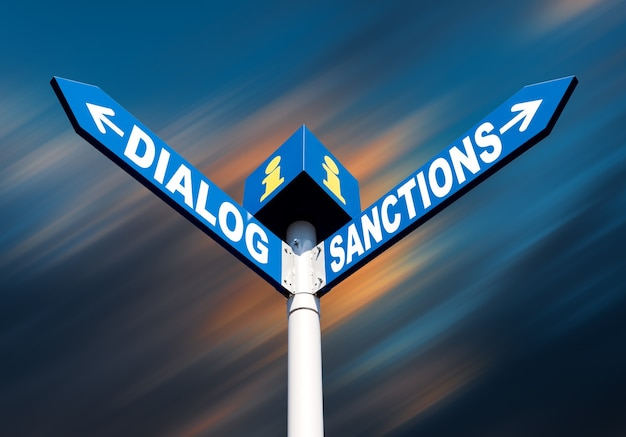 Koncepcja metafory politycznej. waymark ze słowami dialog i sankcje na abstrakcyjnym rozmytym tle