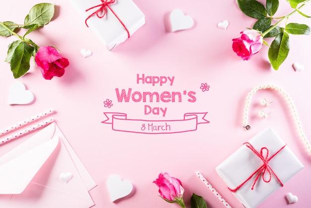 Koncepcja międzynarodowy dzień kobiet na jasnym różowym pastelowym tle