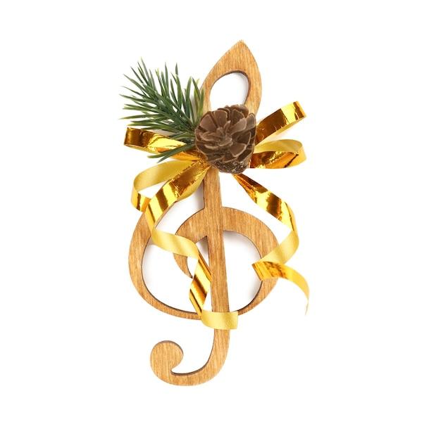 Koncepcja muzyki boże narodzenie. ozdobny klucz wiolinowy z kokardą, na białym tle
