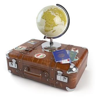 Koncepcja podróży lub turystyki. stara walizka z naklejkami, kulą ziemską i paszportami z biletami na pokład na białym tle. ilustracja 3d