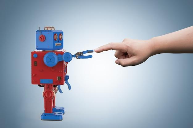 Koncepcja połączenia technologii z blaszaną zabawką robota renderującego 3d łączy się z człowiekiem