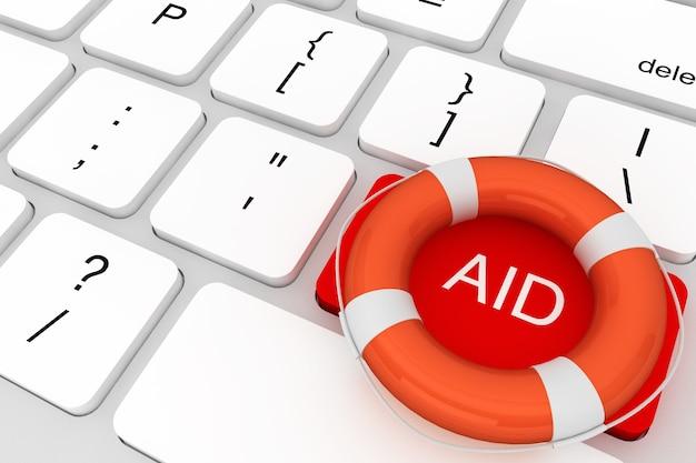 Koncepcja pomocy. klawiatura komputerowa z czerwonym przyciskiem sos i kołem ratunkowym