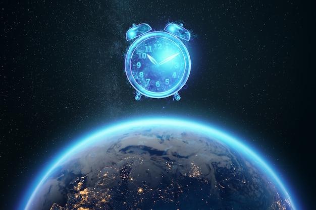 Koncepcja zarządzania czasem, obraz budzika hologram na tle kuli ziemskiej. skopiuj miejsce.
