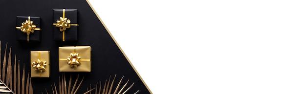 Koncepcje uroczystości z dekoracją złotego pudełka z makietą liścia w ciemności. rocznica i dawanie projektu