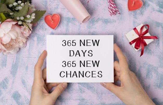 Koncepcyjne pismo odręczne pokazujące 365 nowych dni 365 nowych szans. tekst zdjęcia biznesowego