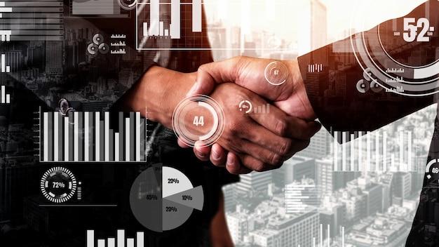 Koncepcyjny biznesowy uścisk dłoni z pulpitem nawigacyjnym do analizy danych finansowych