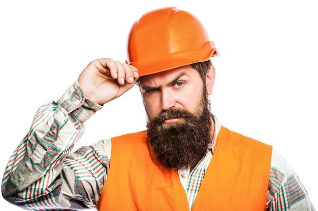 Konstruktorzy, przemysł. architekt portretowy, budowniczy, inżynier budownictwa lądowego. konstruktor w kasku, brygadzista lub mechanik w kasku.