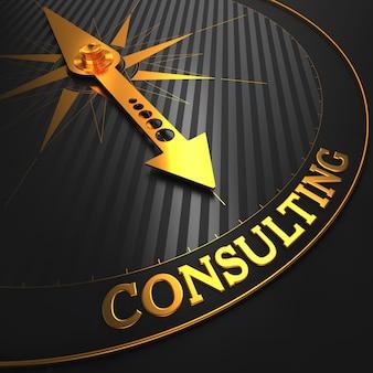 Konsultacje - złota igła kompasu na wskazującym czarnym polu.