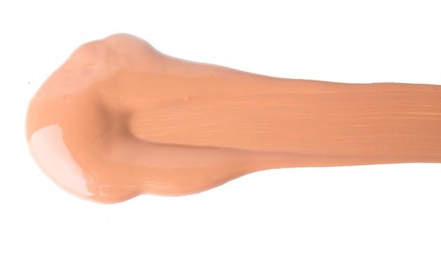Kosmetyk na białej powierzchni