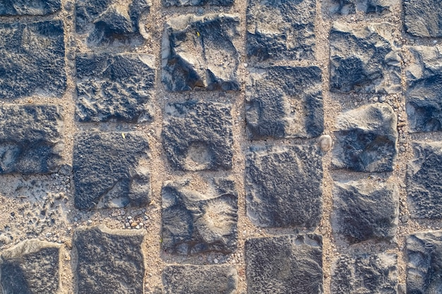 Kostka brukowa, granitowe kamienie kwadratowe, tekstura tło. zdjęcie wysokiej jakości