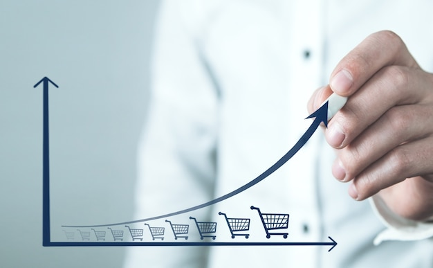 Koszyk zakupów i wykres wzrostu. wzrost sprzedaży