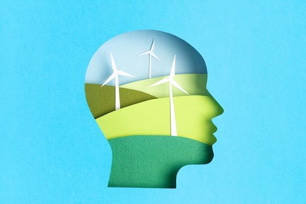 Krajobrazy turbin wiatrowych w głowicy wyciętej z papieru