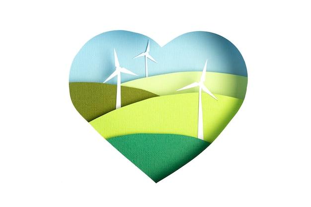Krajobrazy turbin wiatrowych w sercu wyciętym z papieru