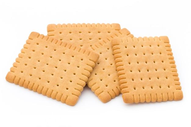 Krakersy masła na białym tle