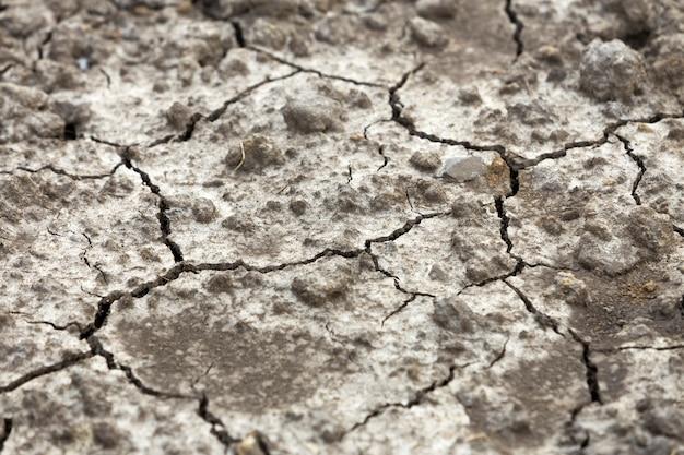 Krakingowego suchego brudu płaska powierzchnia, abstrakcjonistyczna tekstura, kopii astronautyczny tło
