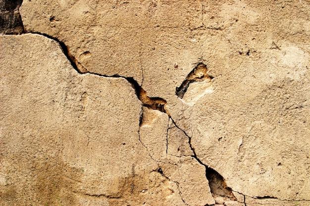 Krakingowy grunge kamienia cementu tło