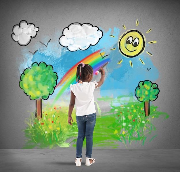Kreatywna dziewczynka koloruje duży ołówek zielony krajobraz